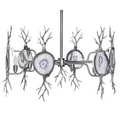<b>Finish: Satin Nickel/Natural Agate</b>  An organic spin on our Eclipse Agate Chandelier with natural agate and brass cast branches.  <i>Emporium Home products are made with natural stones. Variations in the stone colors should be expected and are not considered defects. Stones can be hand selected. Additional fees will apply. Please call for details.</i>