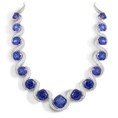 Tanzanite Collar Necklace. Platinum with 15 perfectly matched cushion shaped Tanzanites equaling 137.64 carat total weight.