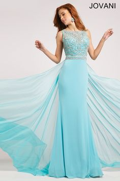 Sleeveless Jersey Embellished Dress Style #21029. Radiant blue sleeveless floor length jersey gown features a beaded embellished bodice and chiffon overlay