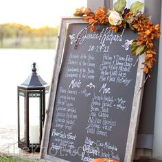 Chalkboard decorated with silk flowers in lieu of traditional programs... money saver!