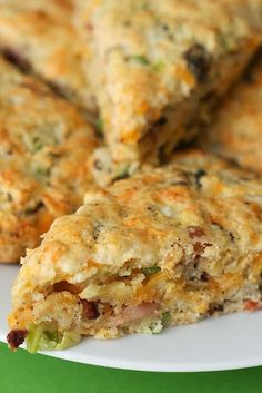 Bacon and Cheddar Scones: 2 cups all-purpose flour, 1 teaspoon baking powder, 1/4 teaspoon baking soda, 1/2 teaspoon salt, 8 tablespoons unsalted butter (frozen), 1/2 cup sour cream, 1 large egg 1 cup shredded cheddar cheese, 1/2 pound bacon (cooked, cooled and chopped), 2 tablespoons finely chopped chives and 1/4 cup heavy cream.