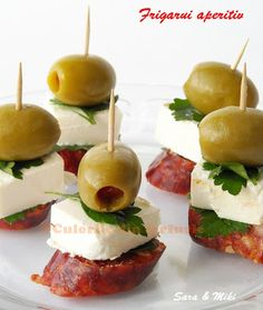 2-colors of skewers appetizer plate - chorizo, goat cheese or feta, green olives, parsley, toothpick