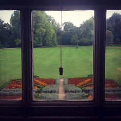 The blind is pulled half down the original paned windows at @mottisfontnt and you can see the ornamental garden in front of the Abbey's mown lawn. #nationaltrust #mottisfont #mottisfontnt #garden #old #traditional #beautiful #design #lawn #flowerbed #flowers #peace #tranquil #beauty #english #grand #country #house #ornamental #window #architecture #symmetry #art #design #vintage #antique #interiour #design #downtonabbey