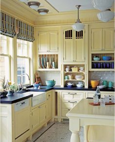 Light yellow cabinets, plaid blinds and colorful d… Farmhouse kitchen design idea.Light yellow cabinets, plaid blinds and colorful dishes - Painted Colorful Kitchen Cabinets Farm Kitchen Ideas, Country Kitchen Designs, Country Kitchen Farmhouse, Primitive Kitchen, Kitchen Rustic, Modern Farmhouse, Country Kitchens, Yellow Kitchen Designs, Country Primitive
