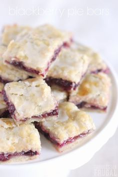 I LOVE this blackberry pie bars recipe! The crust is my favorite part. It is flaky and tender, yet thick enough that you can eat the bars with your hands. No fork necessary. Basically, the sweet berry filling and tender, flaky crust are magical together. Yum! #pie #dessert #blackberry #bars #onthego #recipe #easter #fingerfood