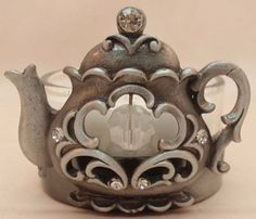 Pewter Teapot. I have never seen a pewter pot of any shape before. I get it this is a pin. lol