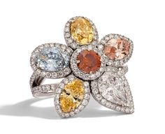 Rosendorff Colours Of The Earth Collection Fancy Diamond Cocktail Ring featuring Fancy Yellow Diamonds, Brilliant Orange Cognac, Pink Marquise Diamond and a Light Blue Oval Diamond all surrounded by Brilliant White Diamonds
