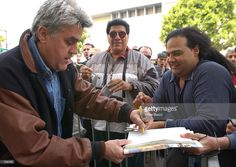 Talk show host and comedian Jay Leno signs autographs for fans at ceremony honoring Rodney Dangerfield with a star on the Hollywood Walk of Fame March 27, 2002 in Hollywood, CA.