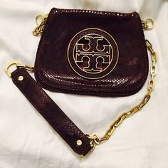 Tory Burch Crossbody Bag It's from Runway. Very unique. It has a kind of 70s style. Top quality. Tory Burch Bags Crossbody Bags