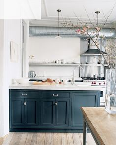 Totally Modern Timelessness - Jenna Lyons' kitchen with  thick poured concrete counters