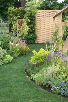 Old & New Garden    By garden designer Imogen Cox Associates. Old & New combines contemporary garden design with traditional plants and materials.