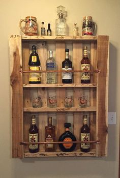 Stunning liquor bottle display made by hand from reclaimed pallet wood. This shelf, finished with copper rods, holds multiple liquor bottles which are stored and displayed beautifully. Built from durable hardwood that is hand selected for color, grain style, and unique characteristics.  Message us for a quote on custom sizes, we will gladly make anything to fit your space perfectly!  32 wide 40 tall The natural style of the wood we choose varies from board to board. Like a snowflake, no two…