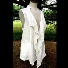 """Free People linen eyelet lace ruffle swing Vest Free People white linen / cotton airy eyelet lace ruffled front swing Vest  front slit pockets * crochet detail down back  New With Tags  *   Size: Small retail price:  $128.00  52% linen * 48% cotton  Measurements: 19"""" under arm to arm (38"""" around) 42"""" around waist 34"""" long in front * 25"""" long in back Free People Tops"""