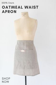 Waist apron with pocket. heirloomed is a 100% linen collection packaged in kraft bags nostalgic of a rustic market bakery and tied with a single waxed thread cord. set upon a classic neutral palette, each heirloomed piece includes a signature tag detail with simple red stitching. Tabletop, Kraft Bag, Waist Apron, Apron Pockets, Neutral Palette, Monogram Styles, Meaningful Gifts, Venice, Bakery
