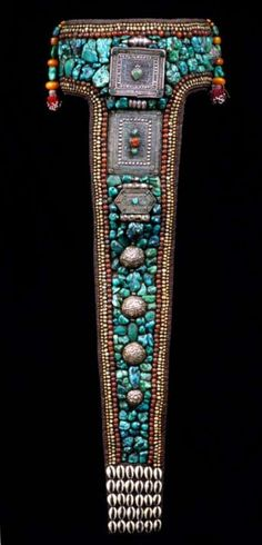 Woman's headdress (perak) from Ladakh, India. Late 20th century Turquoise, textile, fine black wool, cowries and inlaid metal plaque | ©This is just one of the 704 sumptuous...