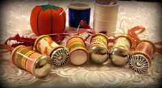 painted or craft paper covered spools with button tops as ornaments