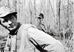 1936. Man with Ivory-Billed Woodpecker - The last known Ivory-Billed was shot & killed in East Texas