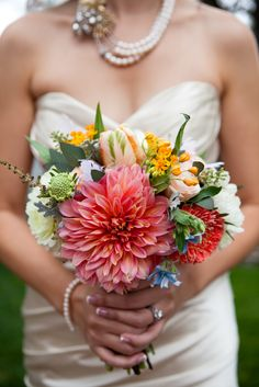 A bright bouquet from a vineyard wedding // photo: Christine Chang Photography // Feature: TheKnot.com