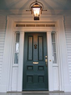 Curtis Giarrusso - USA    Colour: Studio Green No. 93    Finish: Exterior Eggshell for the door. Very light gray house?