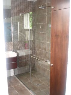 I like frameless doors for bathroom showers and the flush floor into the shower.  only thing that would make this better is if it wasn't a sliding door.