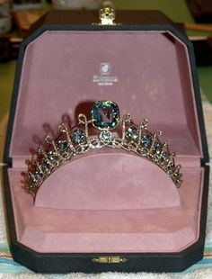 "Princess Isabella de Ligne de La Trémoïlle. Belgian noble house of Ligne. The tiara, created by Holemans, features a large central aquamarine book-ended by smaller aquamarines. The piece also features diamond script ""Ls"" as a major feature of the design."