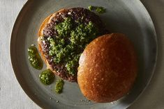An all-American classic acquires an Italian accent in chef Massimo Bottura's umami-rich burger loaded with Parmigiano-Reggiano and topped with salsa verde and a tangy balsamic mayonnaise.