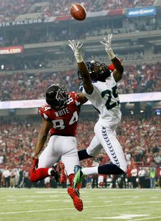 """Richard Sherman <a class=""""pintag searchlink"""" data-query=""""%2325"""" data-type=""""hashtag"""" href=""""/search/?q=%2325&rs=hashtag"""" rel=""""nofollow"""" title=""""#25 search Pinterest"""">#25</a> of the Seattle Seahawks breaks up a pass intended for Roddy White <a class=""""pintag searchlink"""" data-query=""""%2384"""" data-type=""""hashtag"""" href=""""/search/?q=%2384&rs=hashtag"""" rel=""""nofollow"""" title=""""#84 search Pinterest"""">#84</a> of the Atlanta Falcons during the NFC Divisional Playoff Game on 13 Jan 2013"""