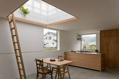 This house located in Hyogo Prefecture in Yamasaki came to us via JA+U (Japan Architecture+Urbanism) and the light-filled, minimalist space is perfect for the often-cloudy location that it's in. Designed by Yo Shimada of Tato Architects, the main part of the home is partially sunken in the ground, which includes the kitchen, living room, and bedrooms.