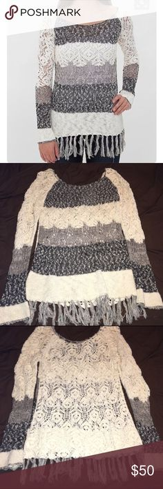 BKE Fringe Sweater This sweater is simply adorable! Featuring a loose knit and fun fringe bottom trim. Perfect to wear oversized! I am typically XS/S and will still pull this out on occasion to wear with leggings and booties. EUC Buckle Sweaters Crew & Scoop Necks