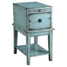 "Wood chairside cabinet with one drawer and a distressed blue finish.Product: Side cabinetConstruction Material: WoodColor: Blue  Features:  One drawer One pull out tray Eye-catching design  Dimensions: 26.25"" H x 19"" W x 14"" D"