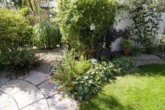Ronde vormen geven een tuin een vriendelijker aanzicht.