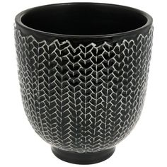 "Swedish design company Eightmood creates stylish, modern accessories that bring inspiration to life. Their footed ceramic Kvist vase has a rich glaze and an organic patterned design that gives it a handcrafted look and feel. Its wide opening makes a beautiful display of any bouquet. 5.5"" diameter, 6"" tall. Ceramic. Hand-wash."