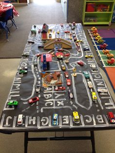 """Preschool Table top car activity- park the right """"letter"""" car in the matching space. Transportation Activities, Car Activities, Preschool Learning Activities, Preschool Curriculum, Alphabet Activities, Preschool Classroom, Preschool Activities, Kindergarten Tables, Preschool Tables"""