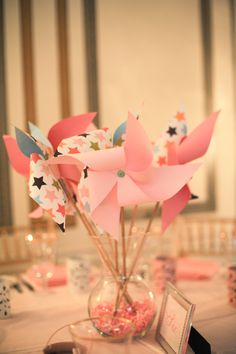 Pinwheel centerpieces - add a little babies breath and some twinkling lights! tada!!