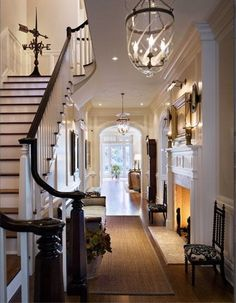 Lanterns in the hallway, black handrail, fireplace, moulding...