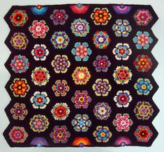 "Beautiful Version of The ""Frida's Flowers Blanket"" Crocheted By Robin Atkins -  FREE PATTERN By Jane Crowfoot **Link to Pattern is on Ravelry** (was originally released as a Crochet Along at Stylecraft Yarns) ● Square /  Block / Hexagon / Flower / Motif / Crochet / Free / Pattern / Janie Crow / Afghan / Blanket / Throw / Colorway / Yarn / Wool / Stylecraft / Crochet Along / CAL  ● Robin Atkin's Page: http://beadlust.blogspot.co.uk/2017/08/fridas-flowers-1-year-crochet-project.html"