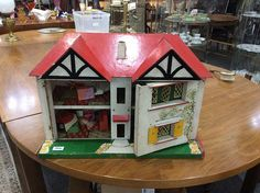 Dolls House, two storey dolls house with a collect