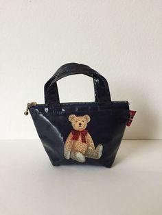 SANRIO HOLLYS BEAR Mini Purse  Hollys Bear is hard to find these days. I miss him!   - The bag is made of plastic coated material - Zipper still works well - 6 long 2.5 wide 6 deep - 1995 - Produced by Sanrio - Made in Japan - Pre-owned condition, sold as is: - Stain from blue dye around Hollys Bears hand,  feet, and a bit on his left ear (Please see photo 4) - From a smoke free home     *Have a question? Please let me know!* :)