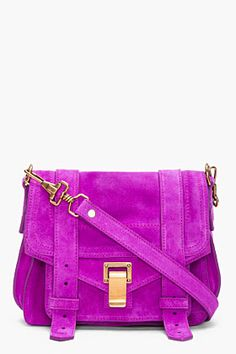 Not sure if I could pull this off but I love the bright color of this purse!