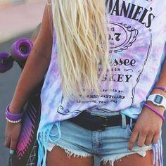 Jack Daniels whiskey light-grey Tee, short denim shorts, purple skateboard, and blond hair.