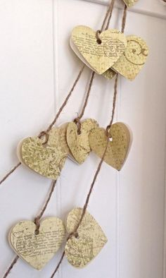 This paper heart garland is approx 5 feet long, each heart is hand punched and is approx. 2 inches in size. This garland is made from high quality paper. Each set of hearts has three total, one white,