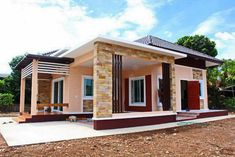 This tropical style one storey house design has 3 bedrooms, 2 bathrooms, 135 square meters total floor area. Proportion is the key in the layout, with the entry Modern Bungalow House Design, Modern House Floor Plans, Small Bungalow, Bungalow Homes, Bungalow House Plans, Small House Design, One Storey House, House Design Photos, House Blueprints