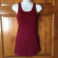 NWT Maroon Burgundy Racerback Tank Top Purchased on EBay with a few other tank tops. I thought that I ordered 2 different shades of red, but got 2 of the same color. Brand New With Tags - still in original bag. You are purchasing the top in Photos 2 & 3. (The one I'm keeping is in photos 1 & 4, but used to show you how it looks.)  Fits like a Medium. Tops Tank Tops