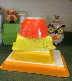 Vintage Me Happy Pyrex.  Juicy and happy.  Reverse Primary (Multi-Color) Orange 402 Daisy Bake Ware Set 913 Yellow Loaf   922 Light Orange Square 933 Orange Lasagne Pan