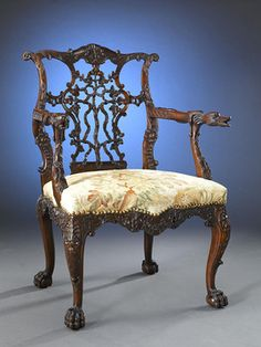 A magnificent 19th-century mahogany arm chair crafted in the George II taste. From the pierced, intertwined ribbon back and duck-form armrests to the hairy ball-and-claw feet, the quality of carving is deep and richly detailed. The seat is upholstered in a lovely 19th-century tapestry that remains in wonderful condition.Circa 1870