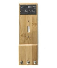 Light Switch Frame Organizer: The wooden frame mounts over a light switch and is equipped with a chalkboard and hooks