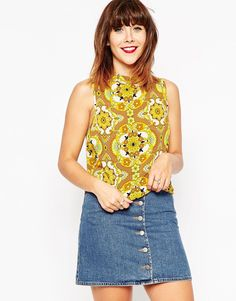 Top by ASOS Collection Smooth woven fabric All-over-print High neckline Cropped design Dip hem Zip back closure Regular fit - true to size Machine wash 100% Polyester Our model wears a UK 8/EU 36/US 4