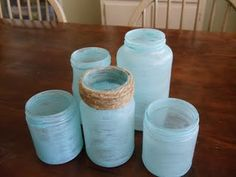 Faux sea glass jars--awesome!--can wrap a twine loop around the top to make hanging lanterns