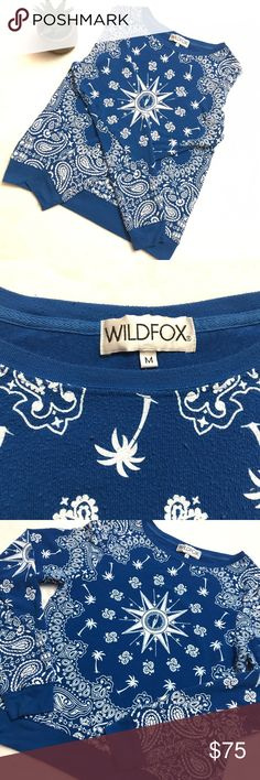 WILDFOX Blue Bandana Print Beach Jumper Top WILDFOX Blue Bandana Print Beach Jumper Top size medium. Slightly oversized and relaxed worn in each jumper by WILDFOX. All over bandana print. If you are not familiar with Wildfox, please be aware their style is a well-worn oversize baggy look. Based on their style this top is in excellent condition. Wildfox Tops Sweatshirts & Hoodies