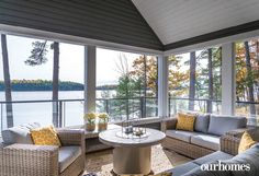 """A three-season Muskoka room opens to an exterior deck and panoramic view of Lake Rosseau. See more of this home in """"Get the Royal Treatment on Muskoka's Royal Island"""" from OUR HOMES Muskoka Spring 2017: http://www.ourhomes.ca/articles/build/article/get-the-royal-treatment-on-muskokas-royal-island #cottage"""